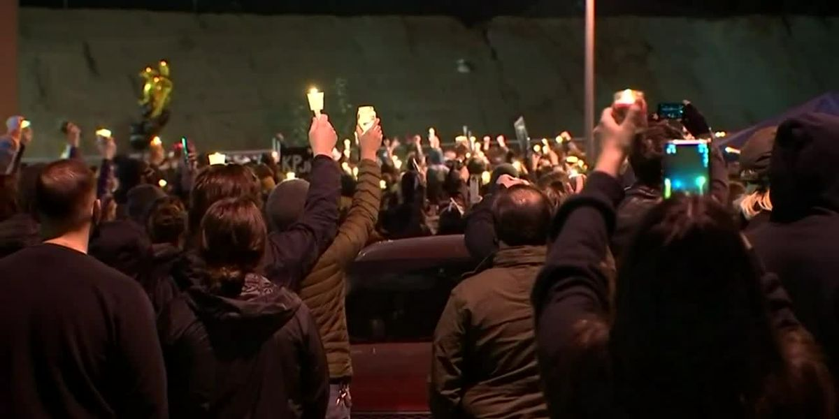 Protesters march through downtown Vancouver, Washington, after vigil for man who was shot and killed