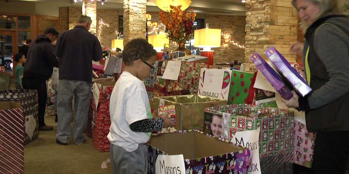 Dozens of Mason's Toy Box volunteers sort toys for UVA Children's Hospital