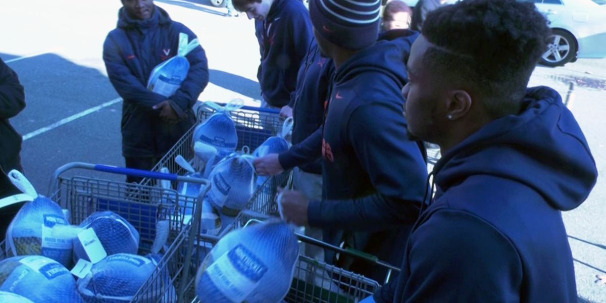 UVA football players hand out turkeys at Loaves and Fishes Food Pantry