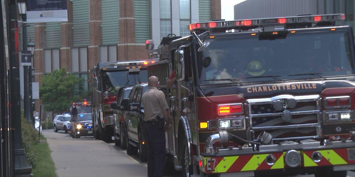 Public safety officials escort family leaving UVA Medical Center
