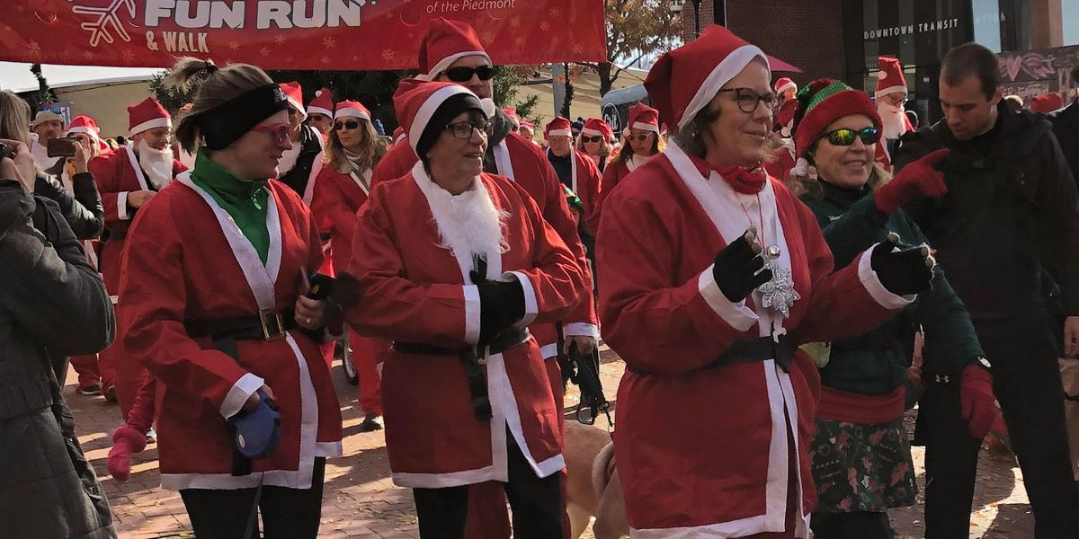 Hundreds of Santa Claus-clad joggers run in 6th Annual Santa Fun Run and Walk