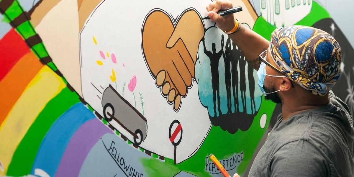 Muralists making the walls at UVA's psychiatry unit a bit brighter