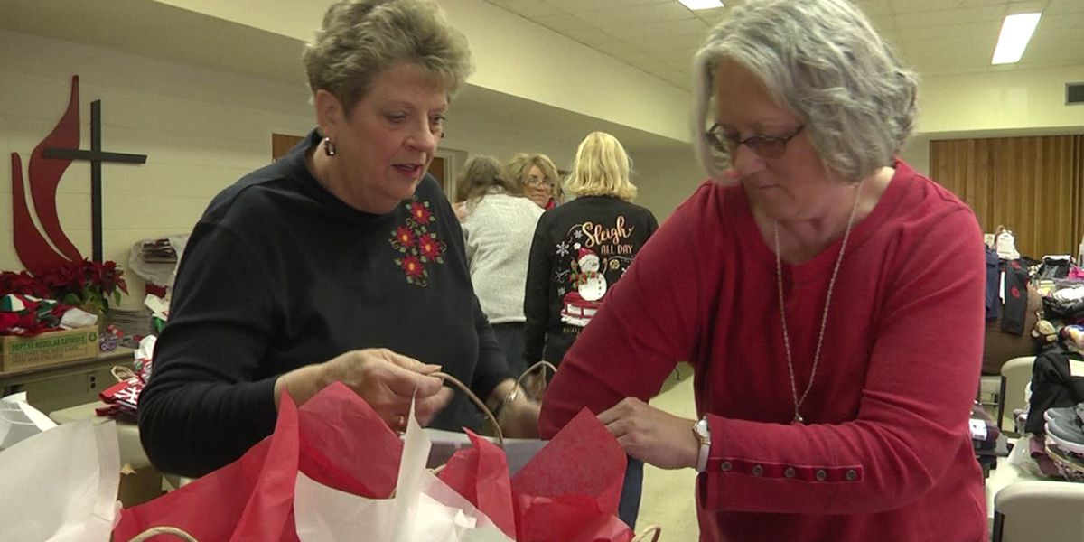 St. Paul's United Methodist Church volunteers wrap presents for area shelter