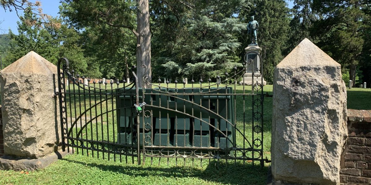 Lock and barricade found at entrance of UVA cemetery with Confederate memorial