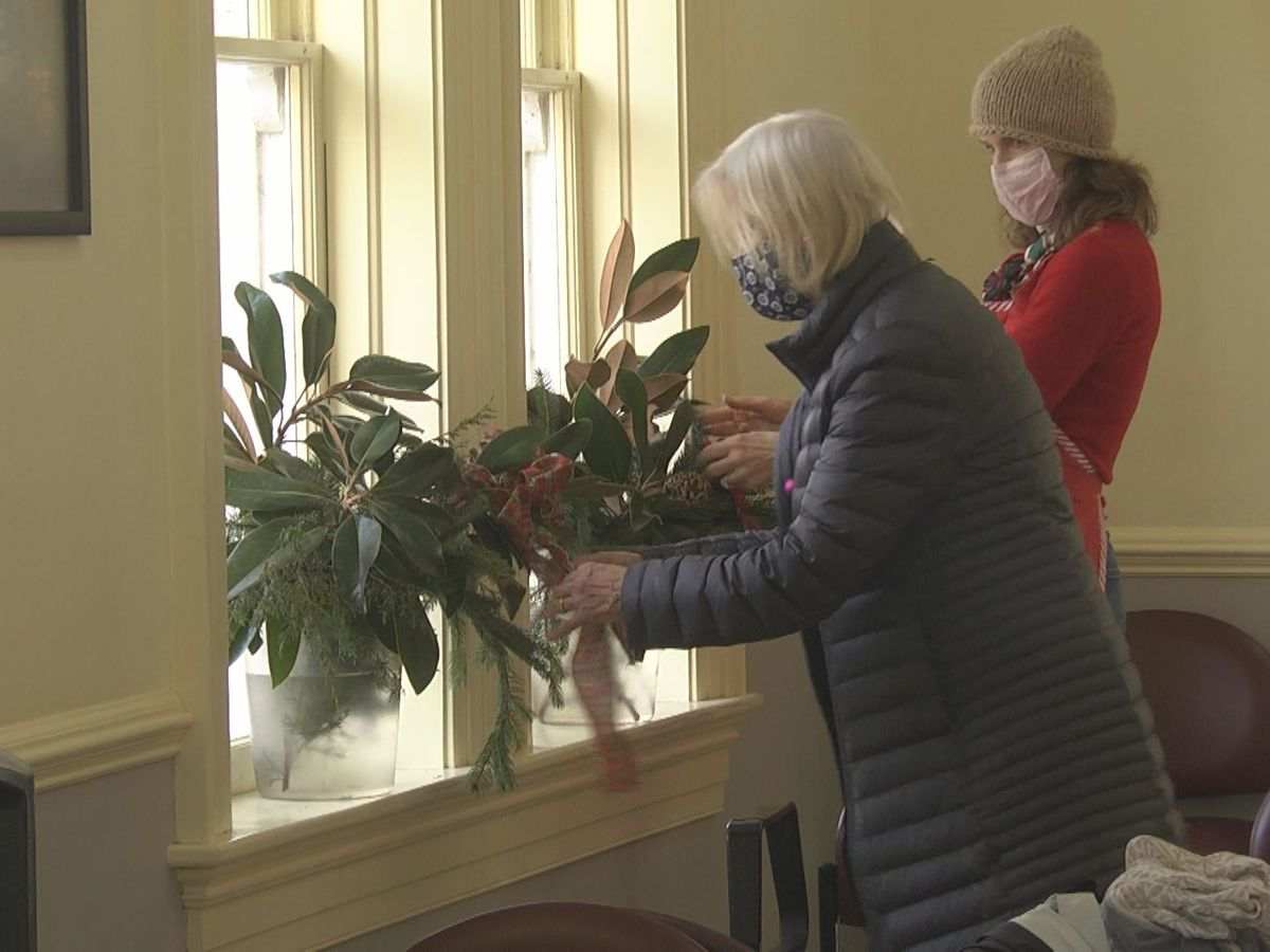 Garden clubs decorate Charlottesville's train station for the holidays