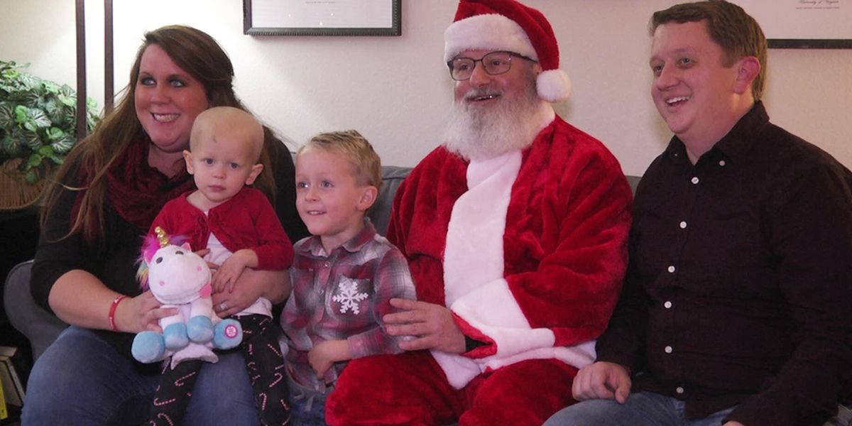 Santa drops off gifts to family housed by Yellow Door Foundation
