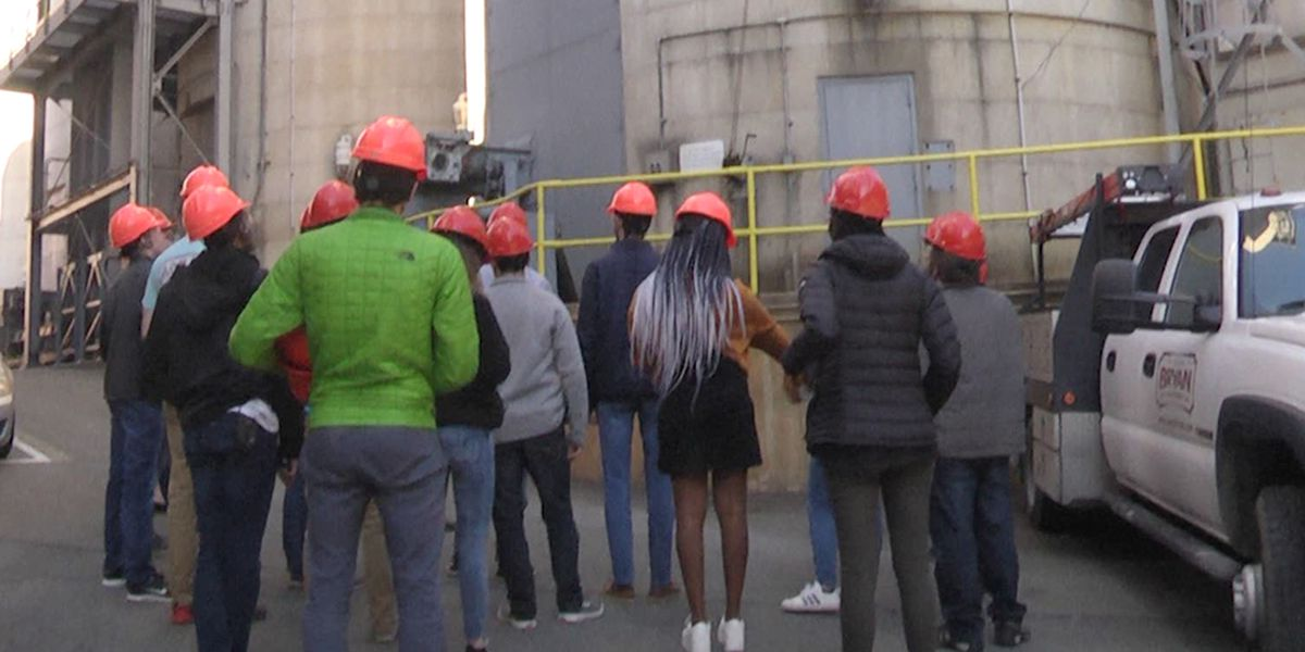 Group tours heating plant at UVA