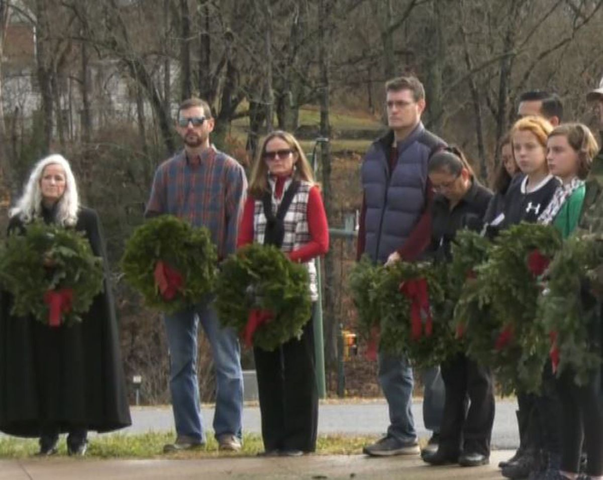 Dozens laid wreaths at Dogwood Vietnam Memorial on Saturday to honor our nation's veterans