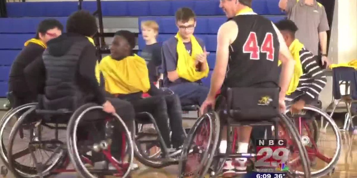 Charlottesville Cardinals show Burley Middle School students how to play on wheels